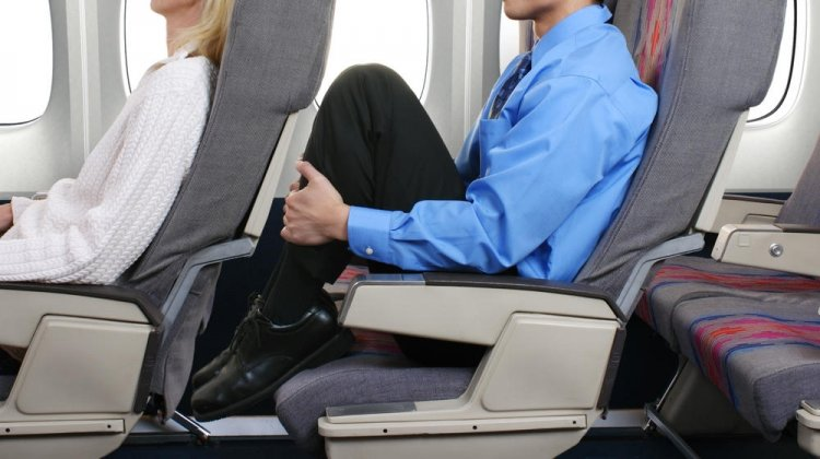 Tall Passengers: Who Should Pay for the Extra Legroom?